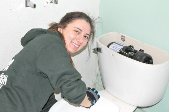 MHYC Corpsmember installing a high-efficiency toilet.